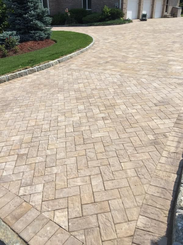 this gorgeous driveway was created using sahara chestnut lite pavers
