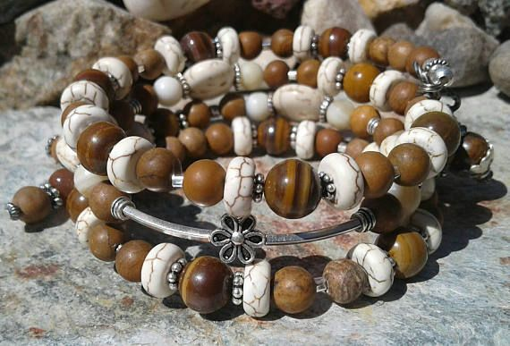 Check out this item in my Etsy shop https://www.etsy.com/listing/536228597/jasper-silver-beaded-memory-wire-wrap