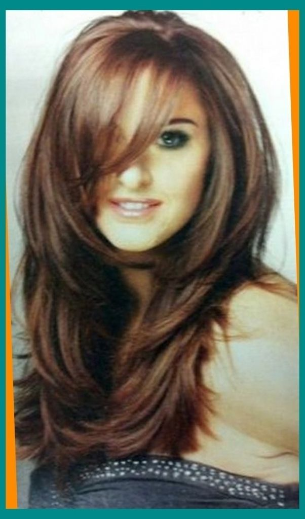 long layered face frame haircut long hair with side bangs and face framing layers haircuts for