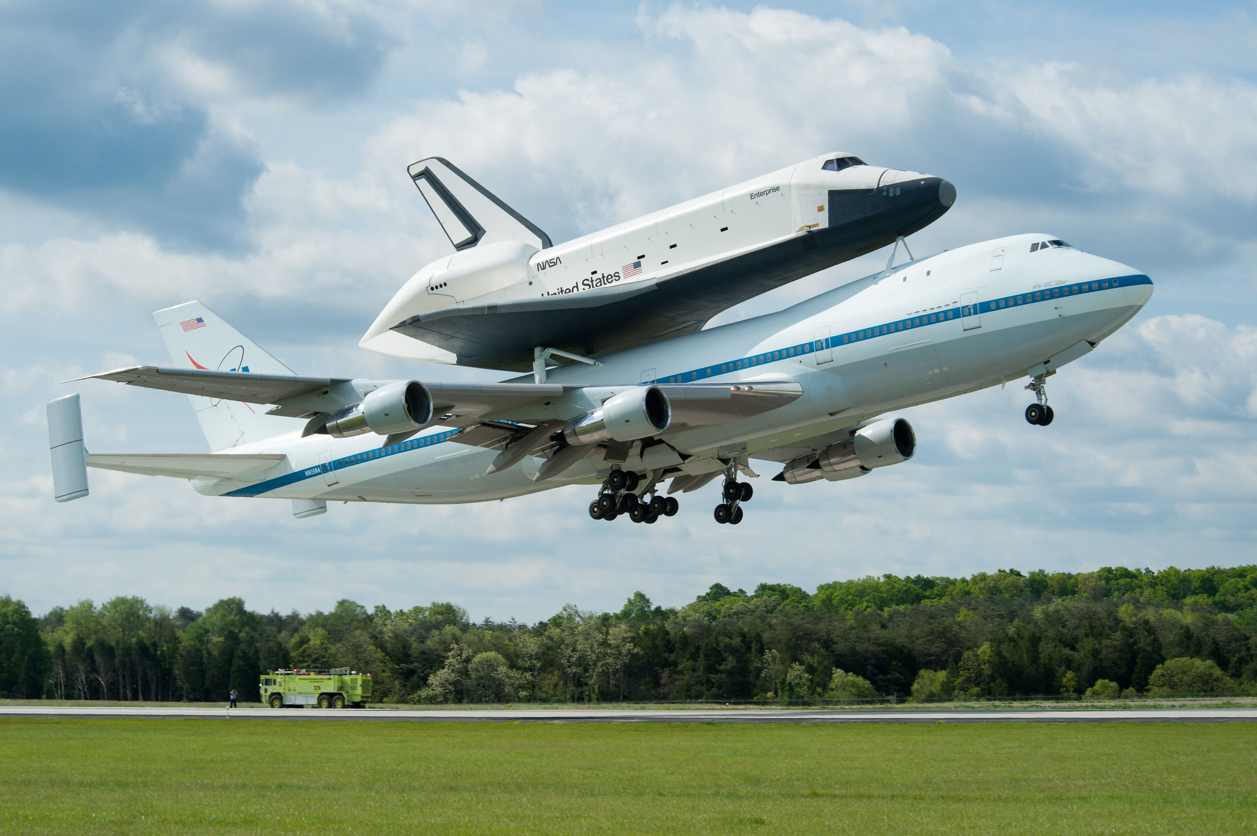 Space shuttle Enterprise is seen as it takes off for New York from Washington Dulles International Airport. Description from ibnlive.in.com. I searched for this on bing.com/images