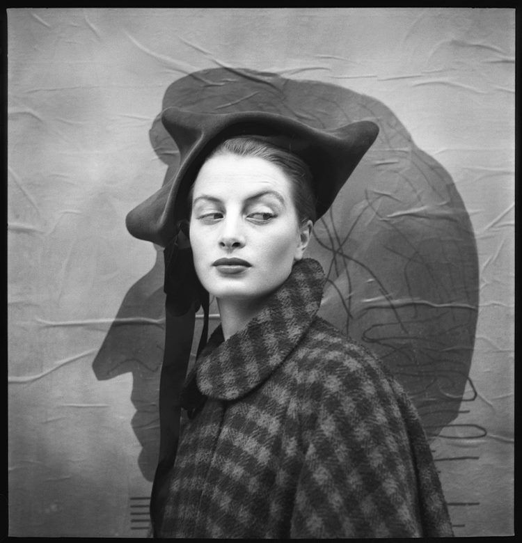 Model/actress Capucine (1928-1990) in a coat and hat by Christian Dior (Paris, 1949). Photo by Richard Avedon.