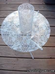 lace doily + vace.  pair with champagne table cloths.