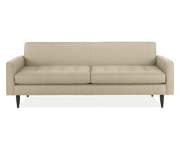 A Small Living Room Sofa With Mid Century Style Reese Has On Tufted Seat Back And Wood Legs