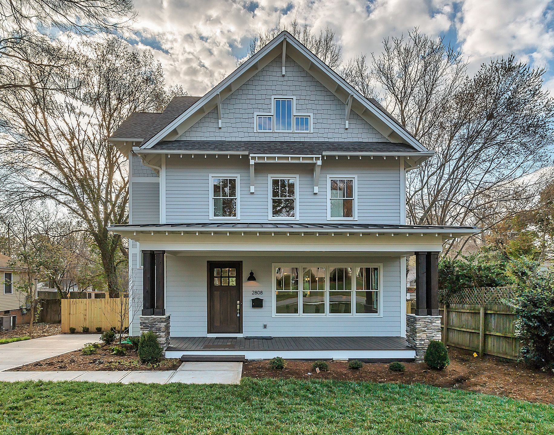 Craftsman home with a rocking chair front porch new custom home plaza midwood charlotte nc grandfather homes