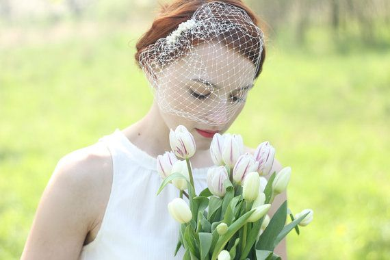 This bridal veil could be a lovely vintage-inspired addition to your bridal outfit. It is attached to a silver tone metal comb (2 - 4cm wide) for an