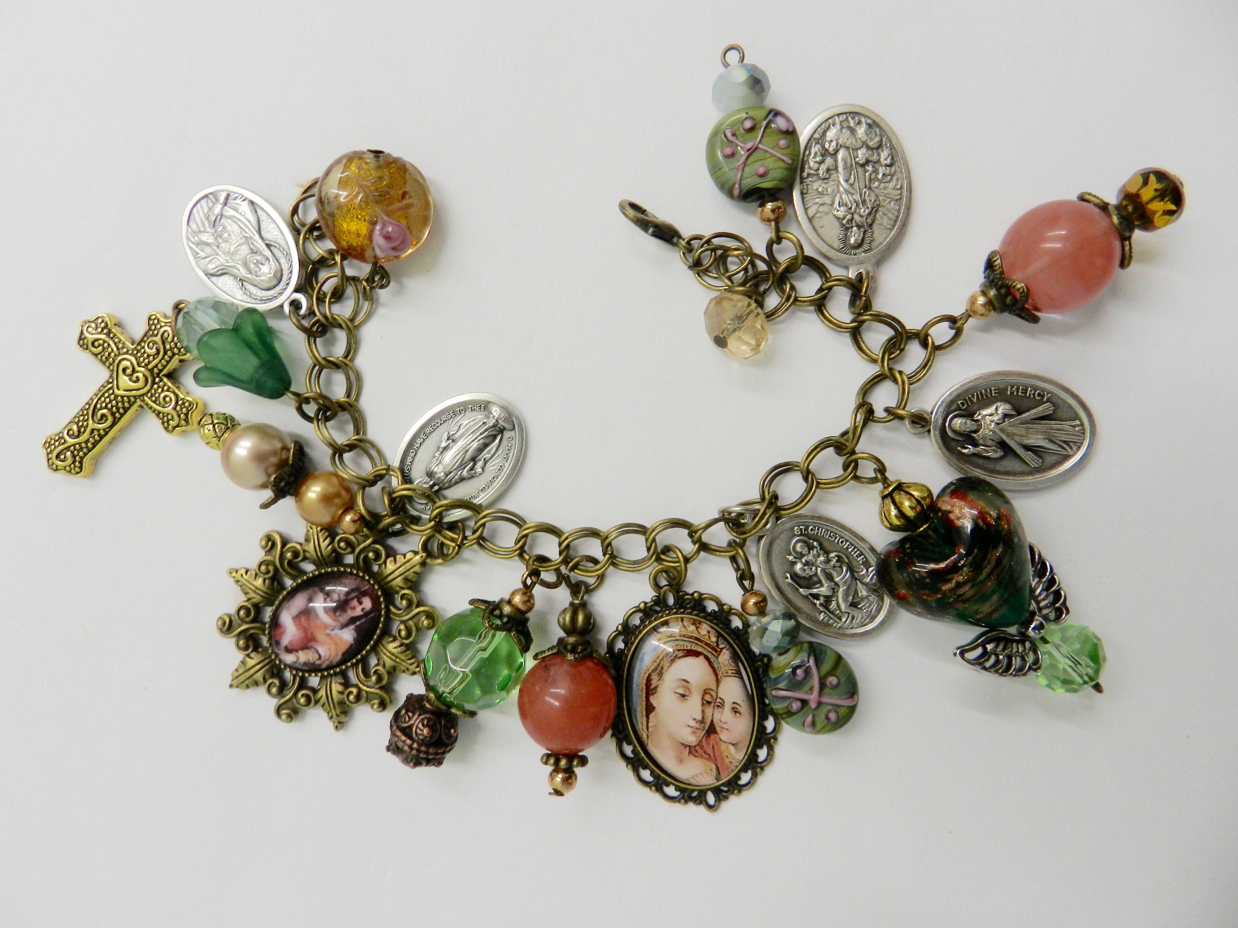 Ornate religious holy medal catholic charm bracelet with two framed