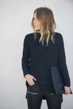 All black. Get the look with a black turtleneck, leather pants, and a black clutch.