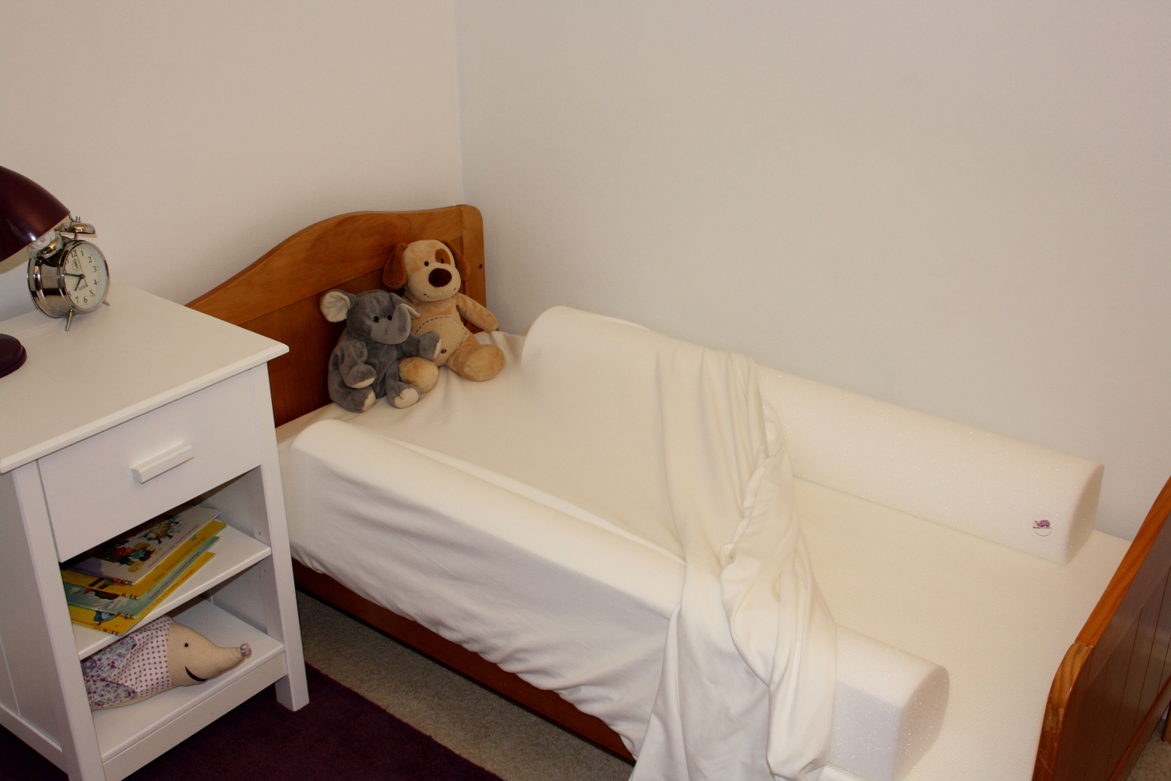 simply place the cot safe foam bed bumpers under a fitted sheet the