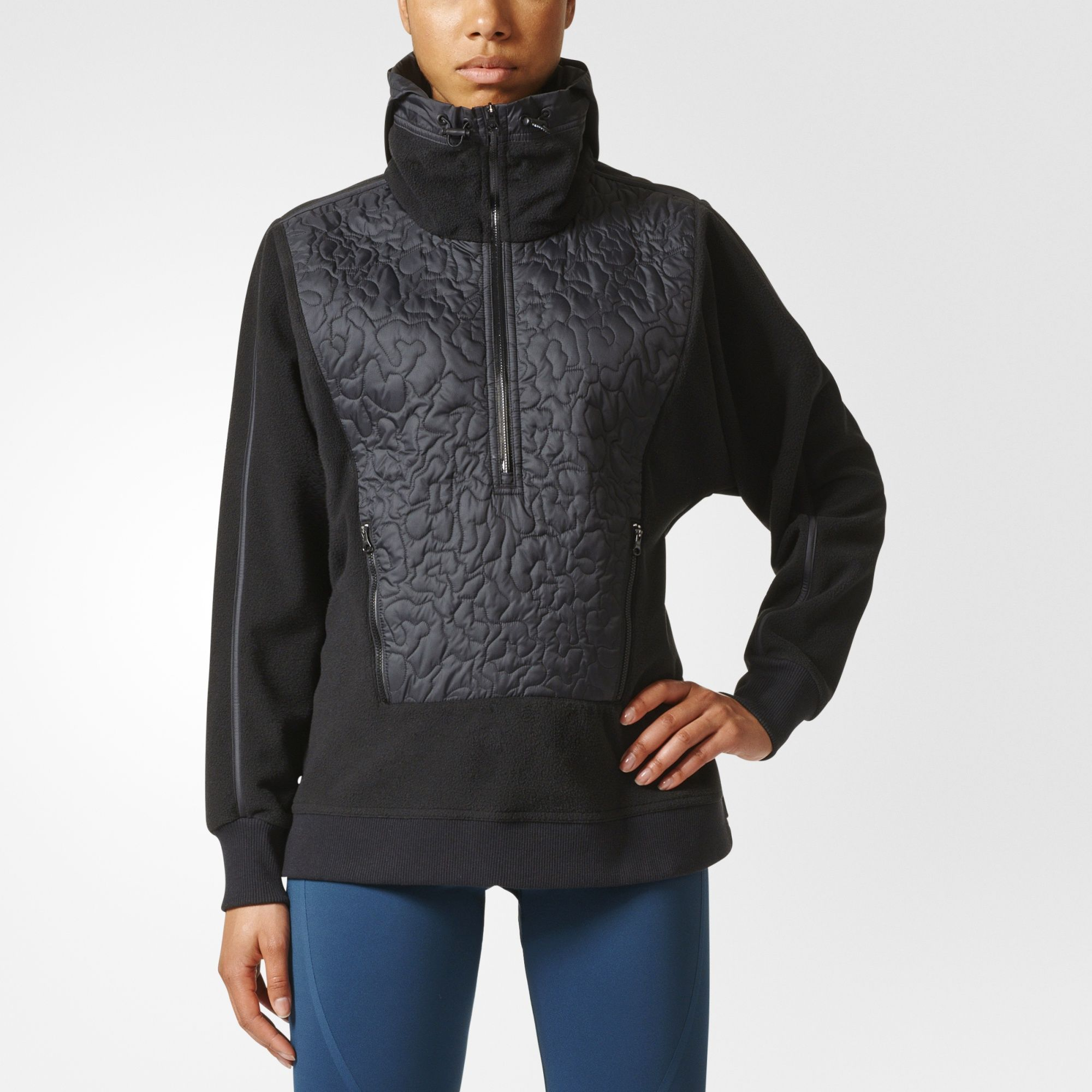 3876db1d04495 Keep your pace through stormy weather in this adidas by Stella McCartney Run  Clima Polar Fleece Pullover. A quilted weather-repellent panel in front  stands ...