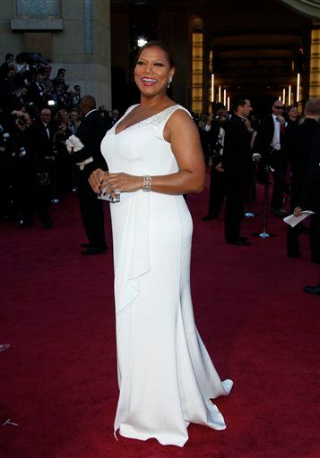 Queen Latifah wears a white Badgley Mischka gown and a Brumani Garden of Senses Couture Collection 18K white gold ring with round diamonds and kunzite at the Academy Awards at the Dolby Theatre in Hollywood on Feb. 24, 2013. || Carlo Allegri / Invision / AP