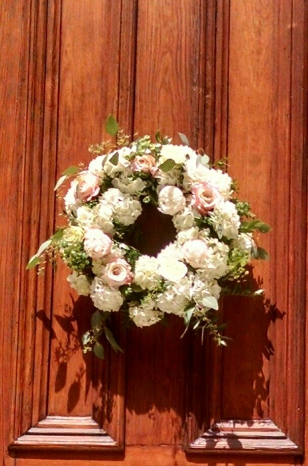 Floral wreath of hydrangea and roses.  In bloom, ltd.
