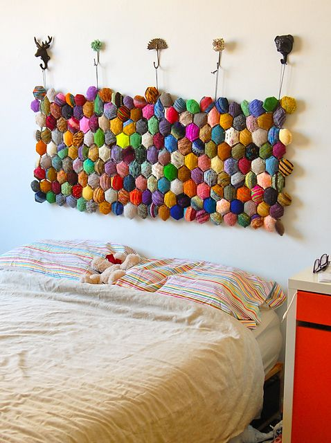 What an excellent way to use up yarn scraps. Super creative and super decorative!  ----  Hexipuff Headboard Wallhanging - Beekeeper's Quilt from Tiny Owl Knits    GENIUS