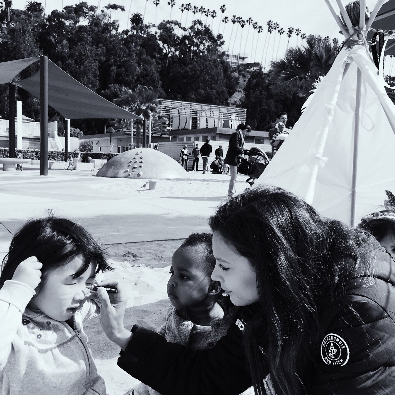 My cousin Camila painting kids faces with native american