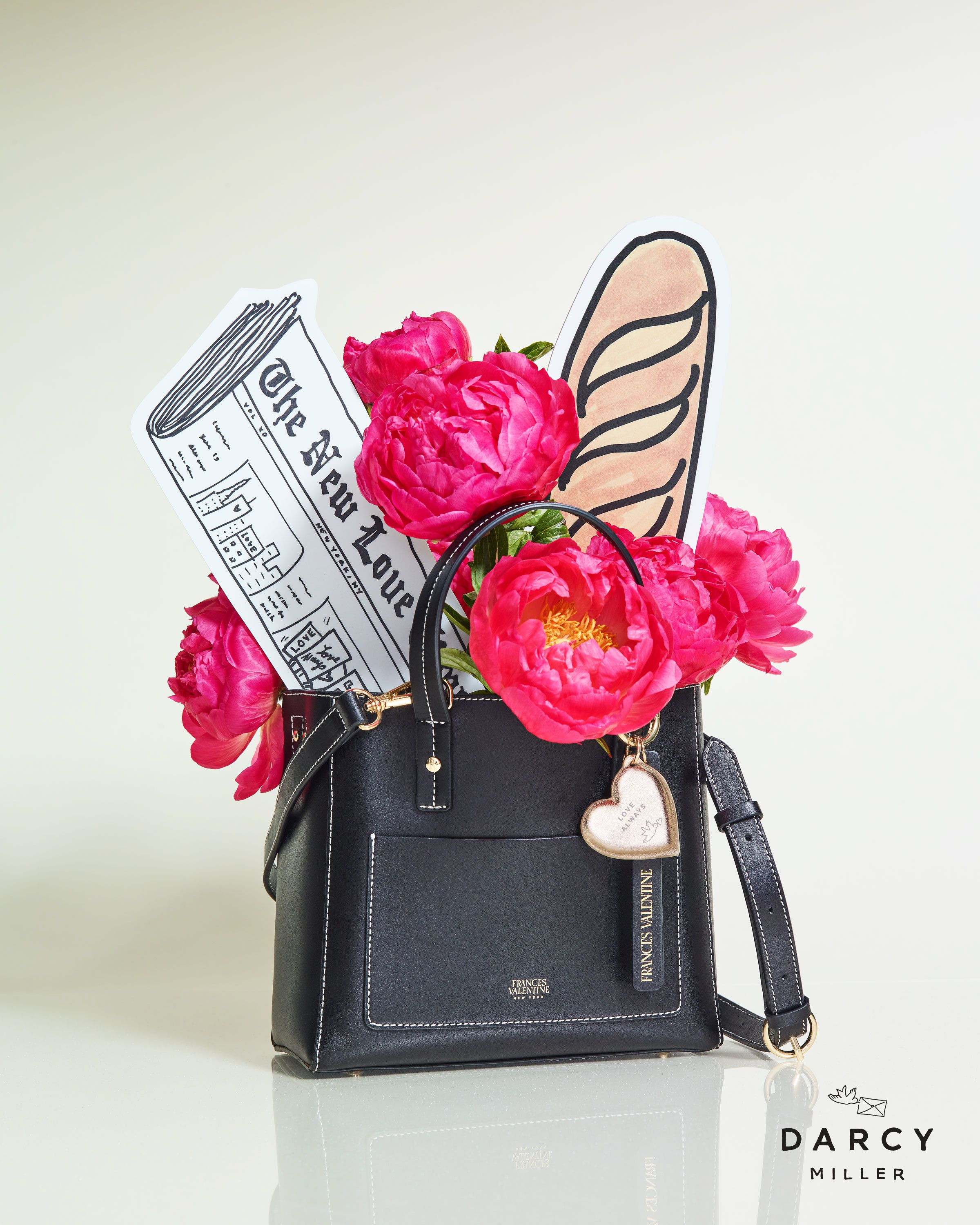 bf61d9e781 Frances Valentine x Darcy Miller Chloe Tote—in timeless black leather or  party-ready gold with a gold, heart-shaped keychain in the signature  lovebird shape ...