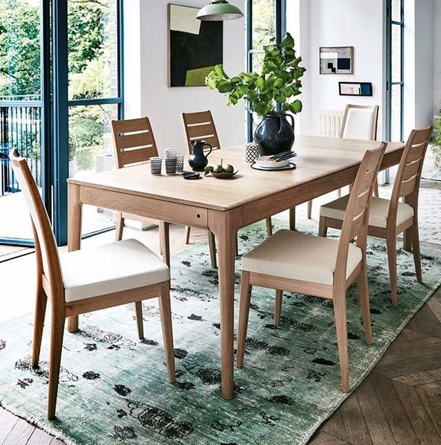 The stylish oak Romana dining table features a beautiful curved edge     The stylish oak Romana dining table features a beautiful curved edge detail  to the long sides of the table top  which combines with the curves and