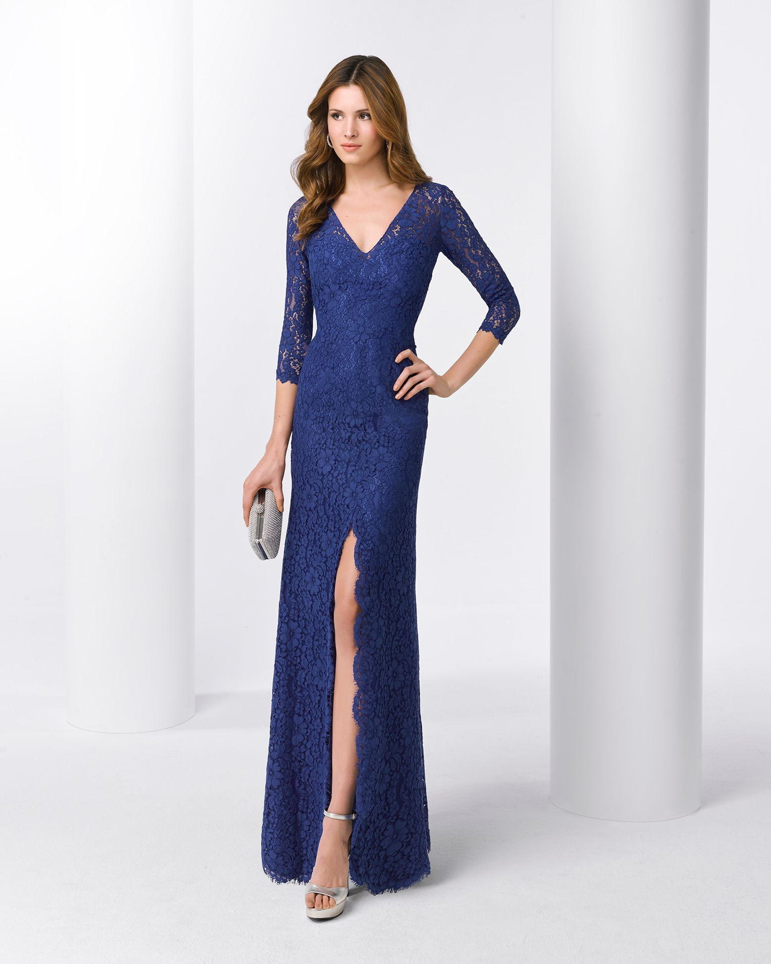 Lace cocktail dress with long sleeves and vneckline available in