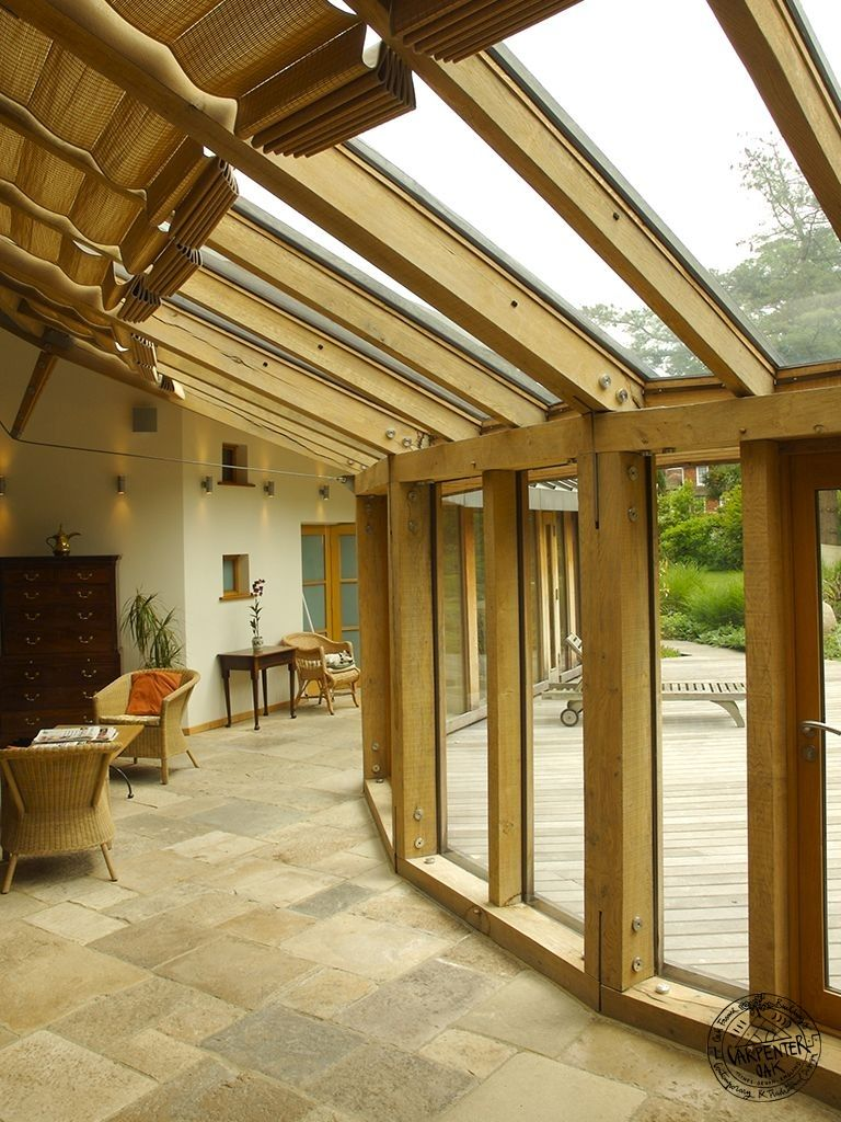 Contemporary curved oak frame conservatory with roof for Contemporary timber frame house plans
