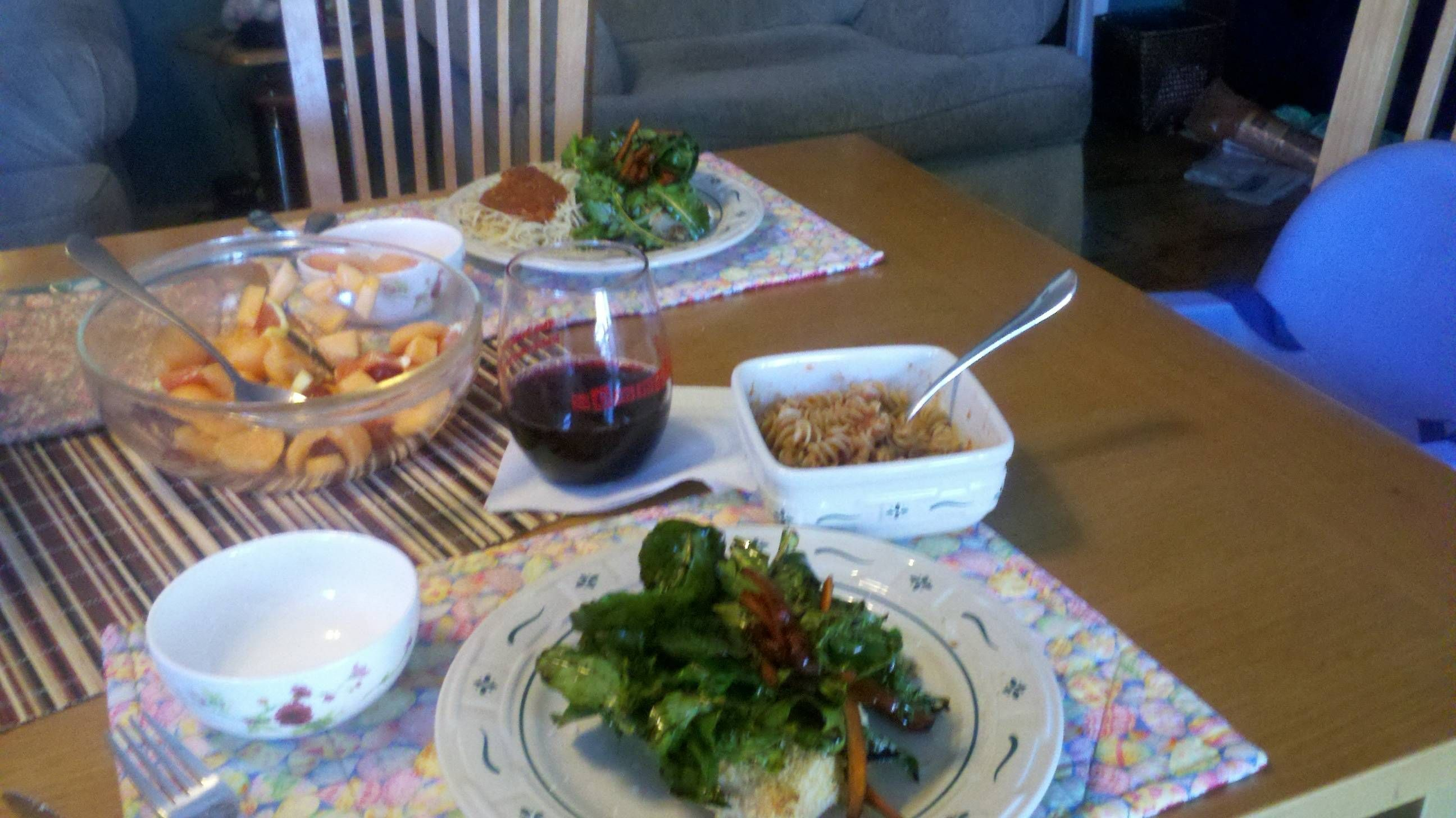 Delish low cal dinner....minus the wine :) Panko crusted chicken, arugula/basil salad w/ bals ...