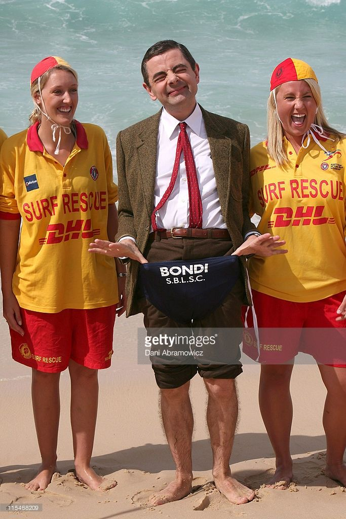 Rowan Atkinson as 'Mr. Bean' with lifeguards during Mr. Bean Comes to Town - Photo Call at Bondi Beach in Sydney, NSW, Australia.