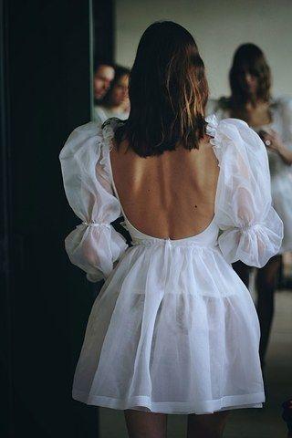 Alexa Chung Met Dress -  Chung taking a moment to reflect on the dress design.  - #Alexa #Chung #Dress #fashiondesign #fashiongirl #met #women'sfashion