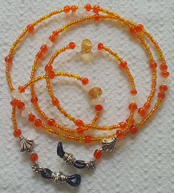 Check out this item in my Etsy shop https://www.etsy.com/listing/513970779/eye-glasses-chain-orange-crystal-glasses