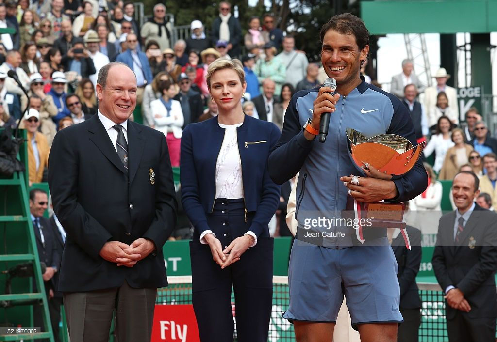 Prince Albert II of Monaco and Princess Charlene of Monaco look on as Rafael Nadal of Spain speaks to the crowd with the trophy after victory in the singles final match against Gael Monfils of France during day eight of the Monte Carlo Rolex Masters at Monte-Carlo Sporting Club on April 17, 2016 in Monte-Carlo, Monaco. (Photo by Jean Catuffe/Getty Images)