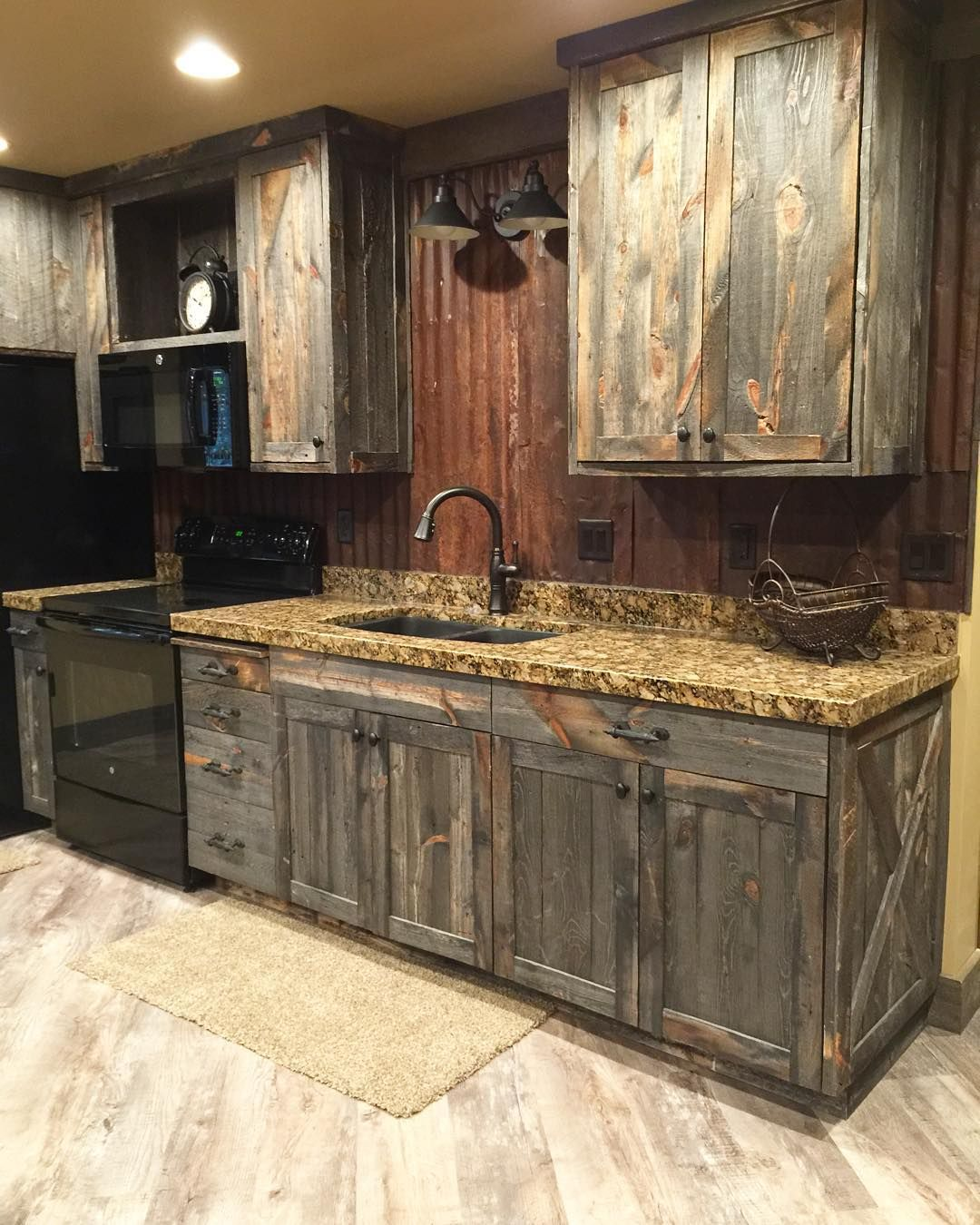 A little barnwood kitchen cabinets and corrugated steel backsplash love how rustic and homey it - Rustic wooden kitchen cabinet ...