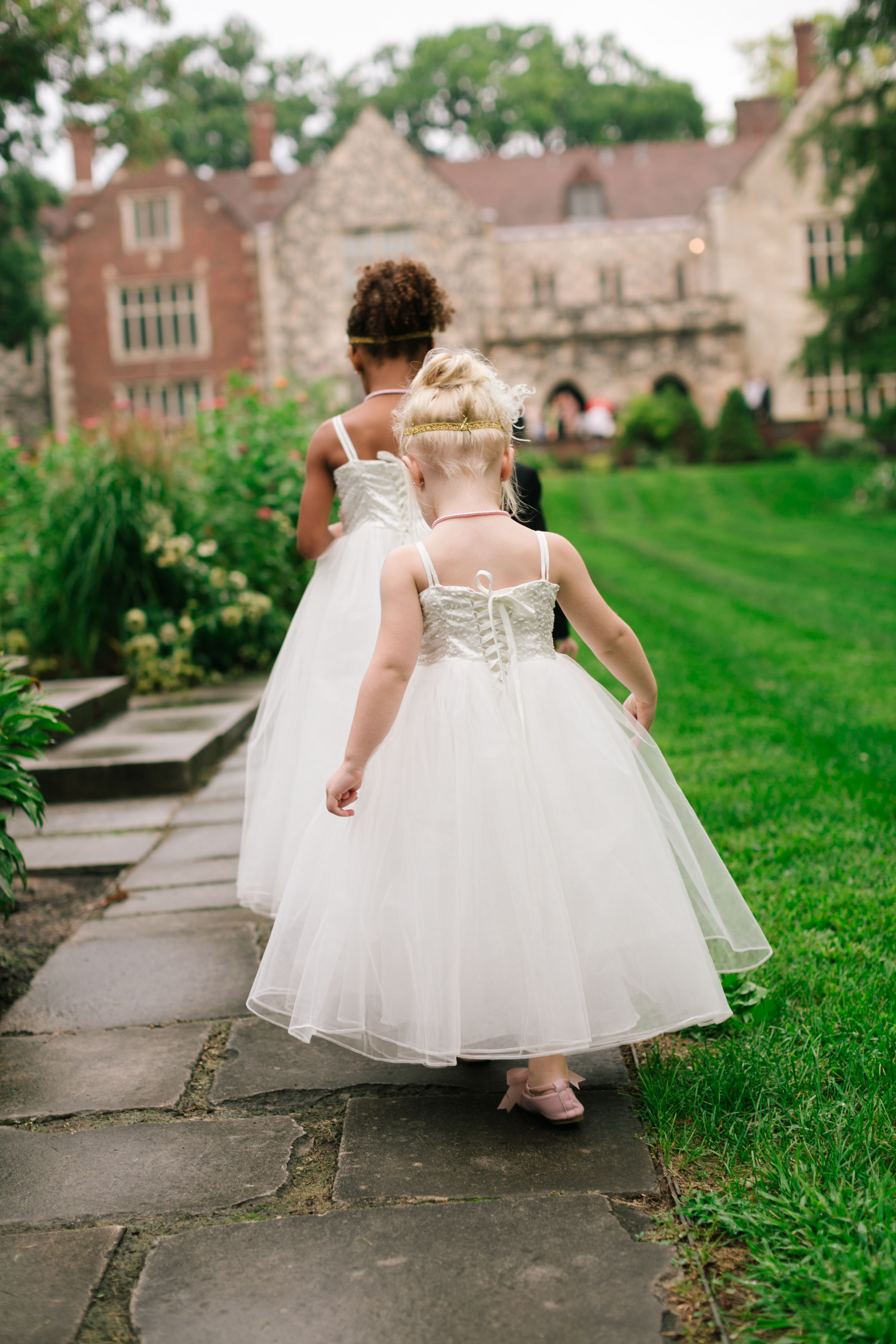 Someday these flower girls will grow up and watch their wedding ...