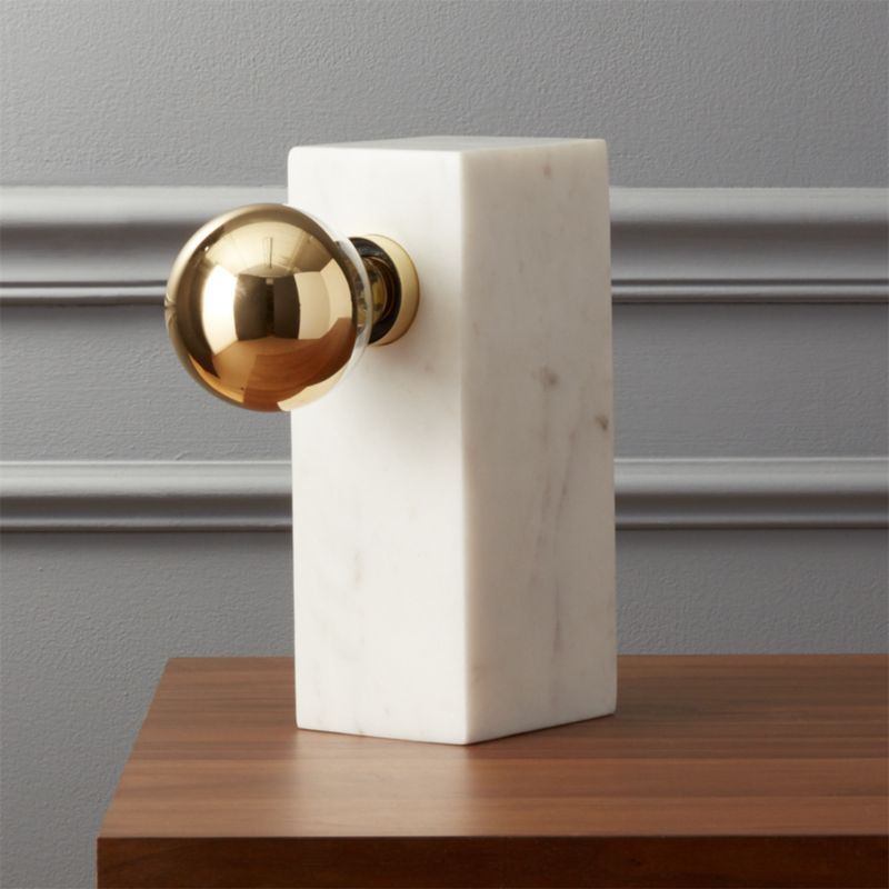 Shop Orsay Marble Block Table Lamp.   Solid marble forms the foundation for a single bulb.  Brass detail adds a sophisticated finish.  A unique modern piece for any room.