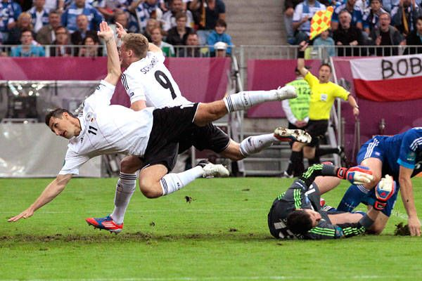 Tumblinggermany S Miroslav Klose And Germany S Andre Schuerrle Fall As They Try To Score A Goal Over Greece Goalkeeper Michalis Sifakis Germany Would Go On To
