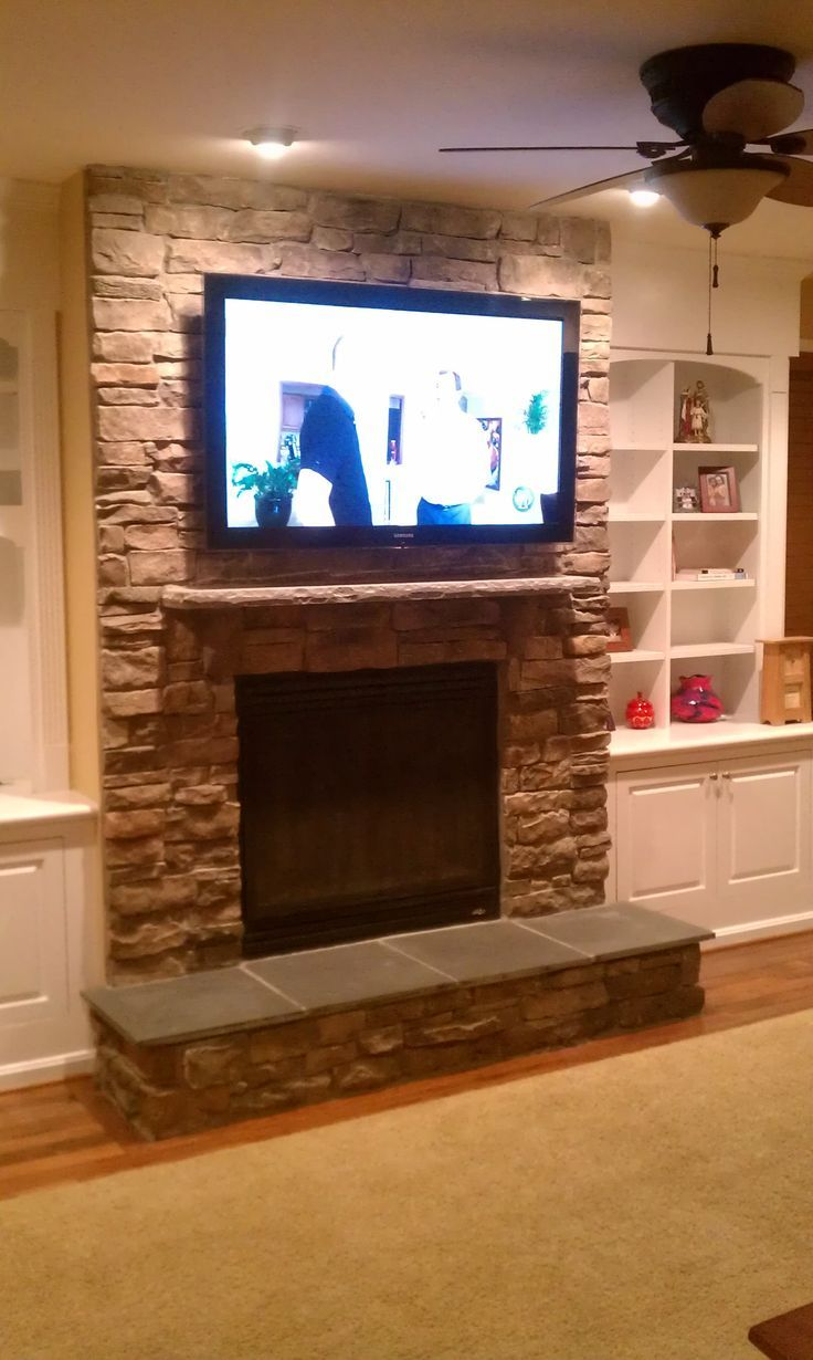 Stone fireplace with tv over fireplace tv installation for Tv over fireplace