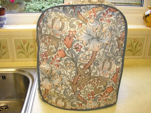 """William Morris """"Golden Lily"""" in shades of peach, grey and brown. Magimix cover.  £24.99"""