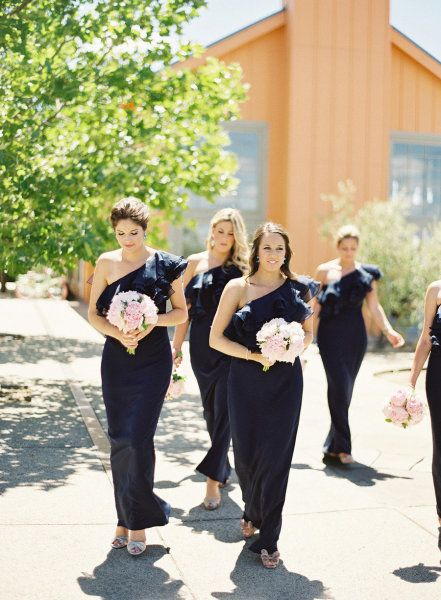Navy one-shoulder bridesmaid dresses.