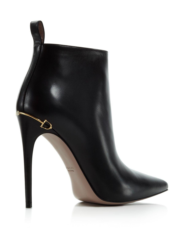 heeled black leather booties