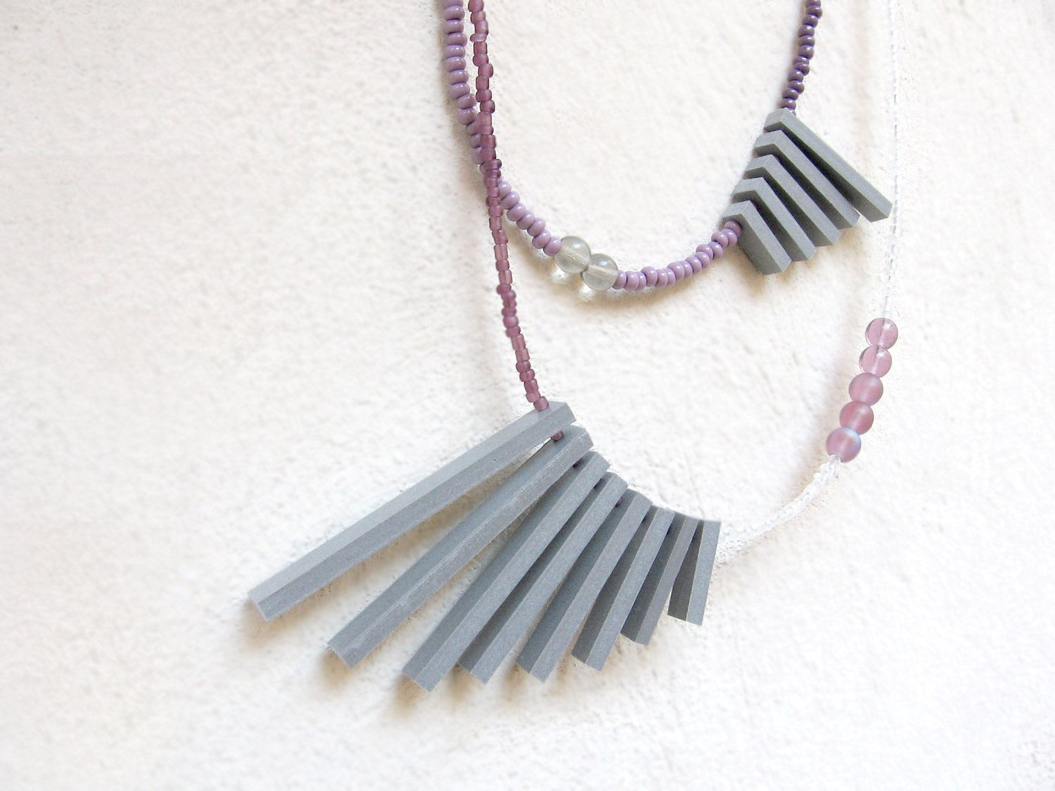 double geometric necklace with grey sticks and purple beads. $24.00, via Etsy.