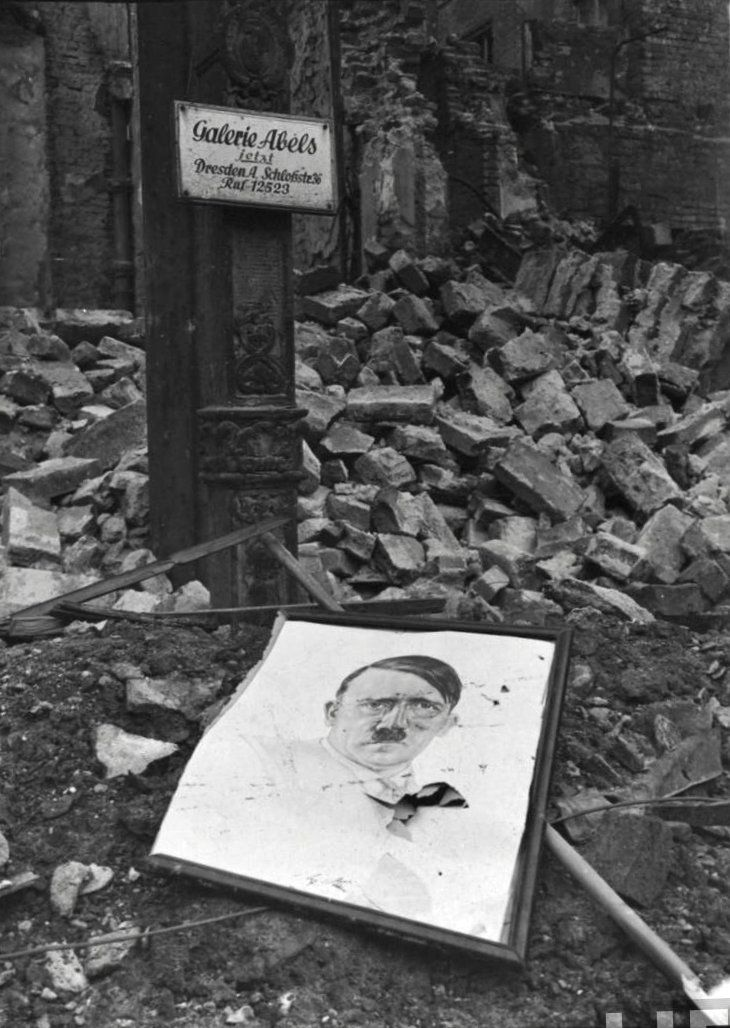 Hitler print among the ruins of an art shop in Cologne, 1945 © Margaret Bourke-White