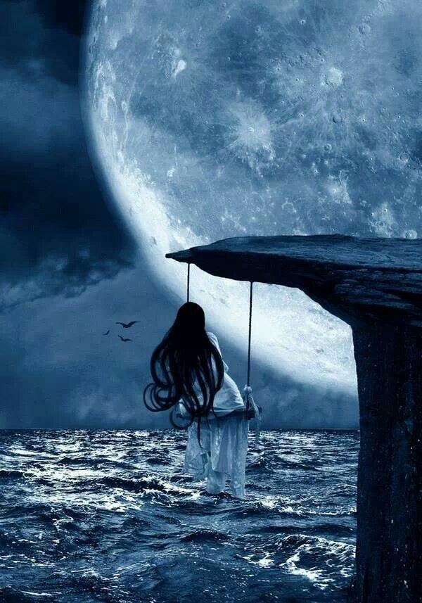 Fairy swinging in moonlight