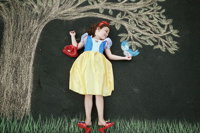 Snow White holds birds. Alexis does not.