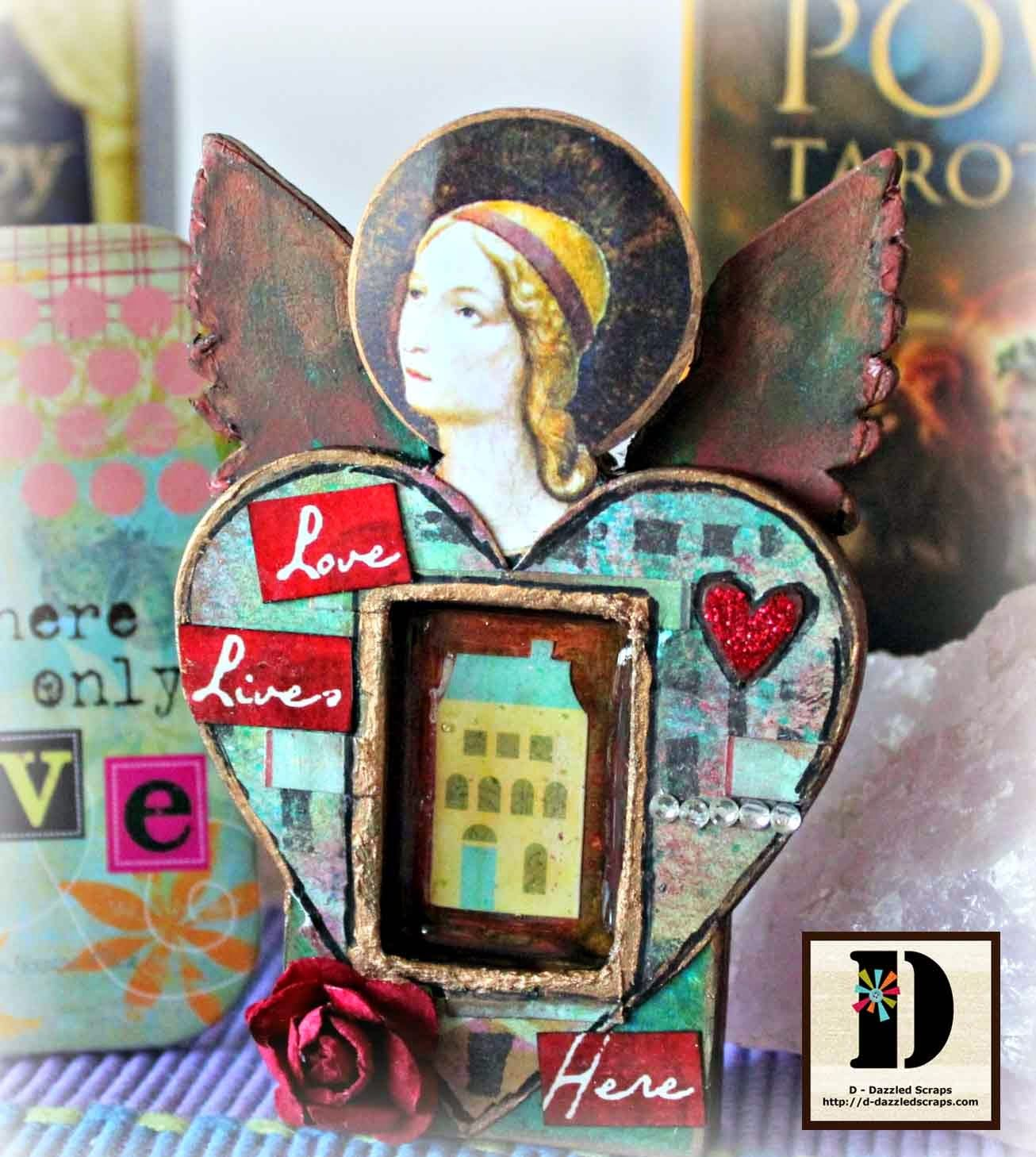 I then decorated her body and wings with a scrap piece from a Gelli Print and her main body (the heart) with a piece I created using stencils and my Pan Pastels.  D-Dazzled Scraps: Love Lives Here - A Sweetheart Fairy Shrine