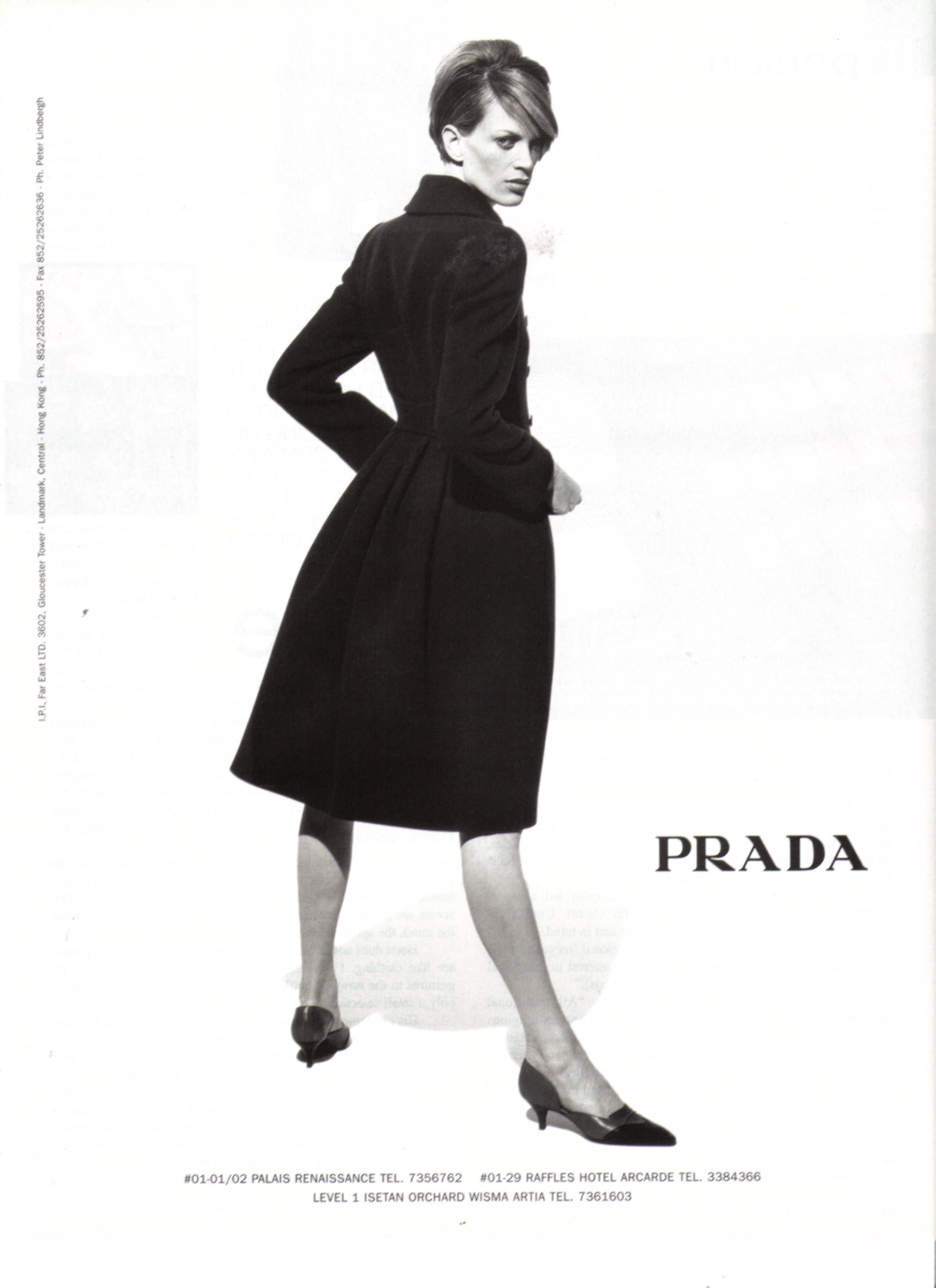 b774ebbd5a30 Prada 1990s ad. Minimalist design element in the chic plain black coat.  Understated yet powerful because the design is a classic. Neutral colors  and modest ...