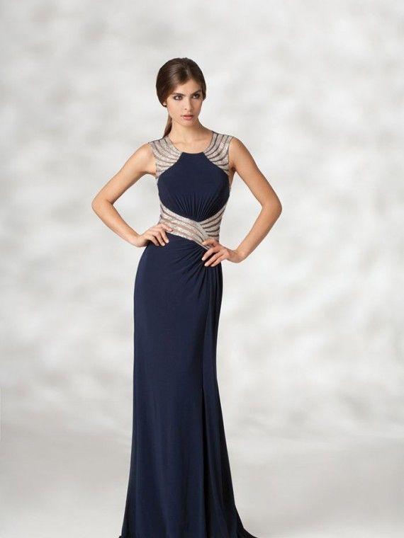9855b2797 Vestido comprido azul escuro com cintura afinada em prateado ligeiramente  transparente