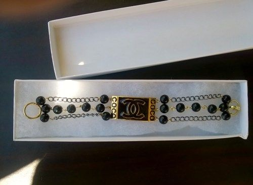 Quite lovely is this  designer inspired Pearl & crystal charm bracelet!  Can be worn both for evening or casual  Perfectly beautiful..  6mm porcelain glazed black glass pearls  Black chain  Fits 7