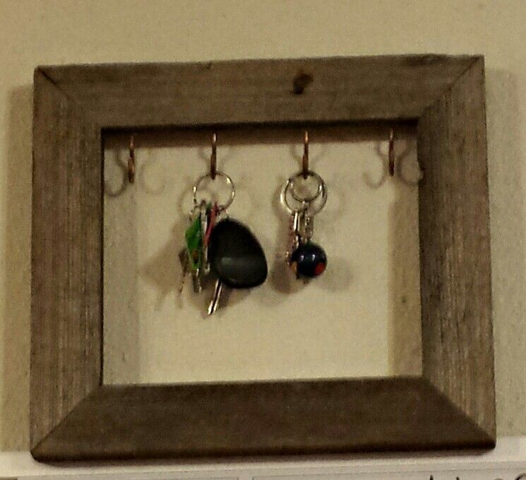 Homemade key holder, made out of an old picture frame and hooks from