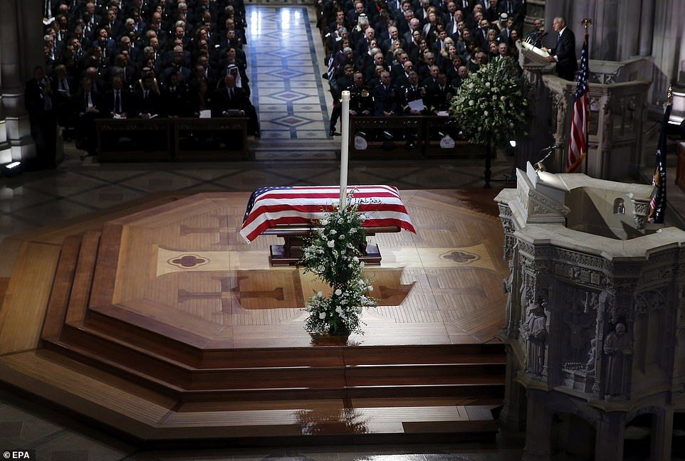 Emotional presidents past and present pay respects to