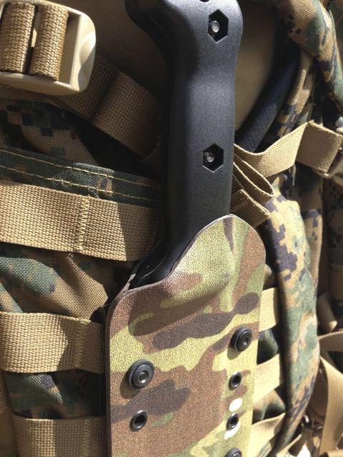 Kabar Becker BK7 in Super Cam Cleveland Kydex Sheath. Molle lok shown binding sheath to USMC Pack.