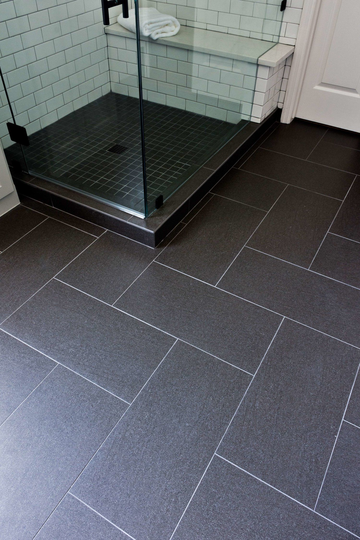 Before And After A Dated Builder Bathroom Becomes An Eye Catching Modern Retreat Designed Black Tile Bathrooms Tile Bathroom Bathroom Remodel Cost