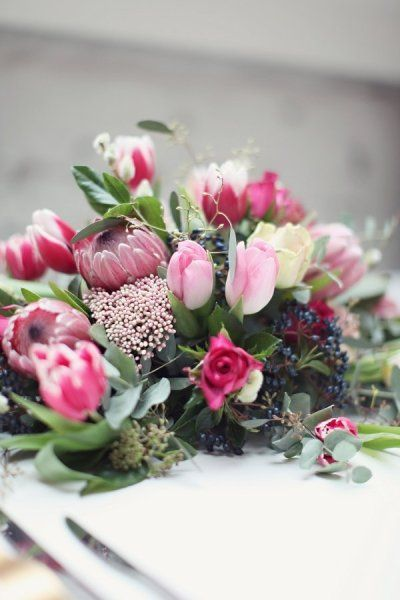 Pink protea and tulips.