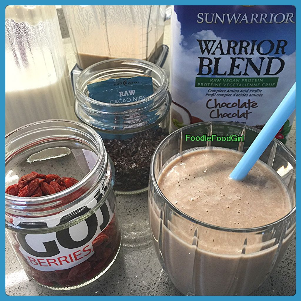 Cravin' a Sweeeet Breakie. Freshly made Organic Almond Milk, #warriorblendprotein (Chocolate), Goji Berries, Cacao Nibs - All #RAW  Thick & Yummy Nut Milk Shake.  #rawsmoothie #organic