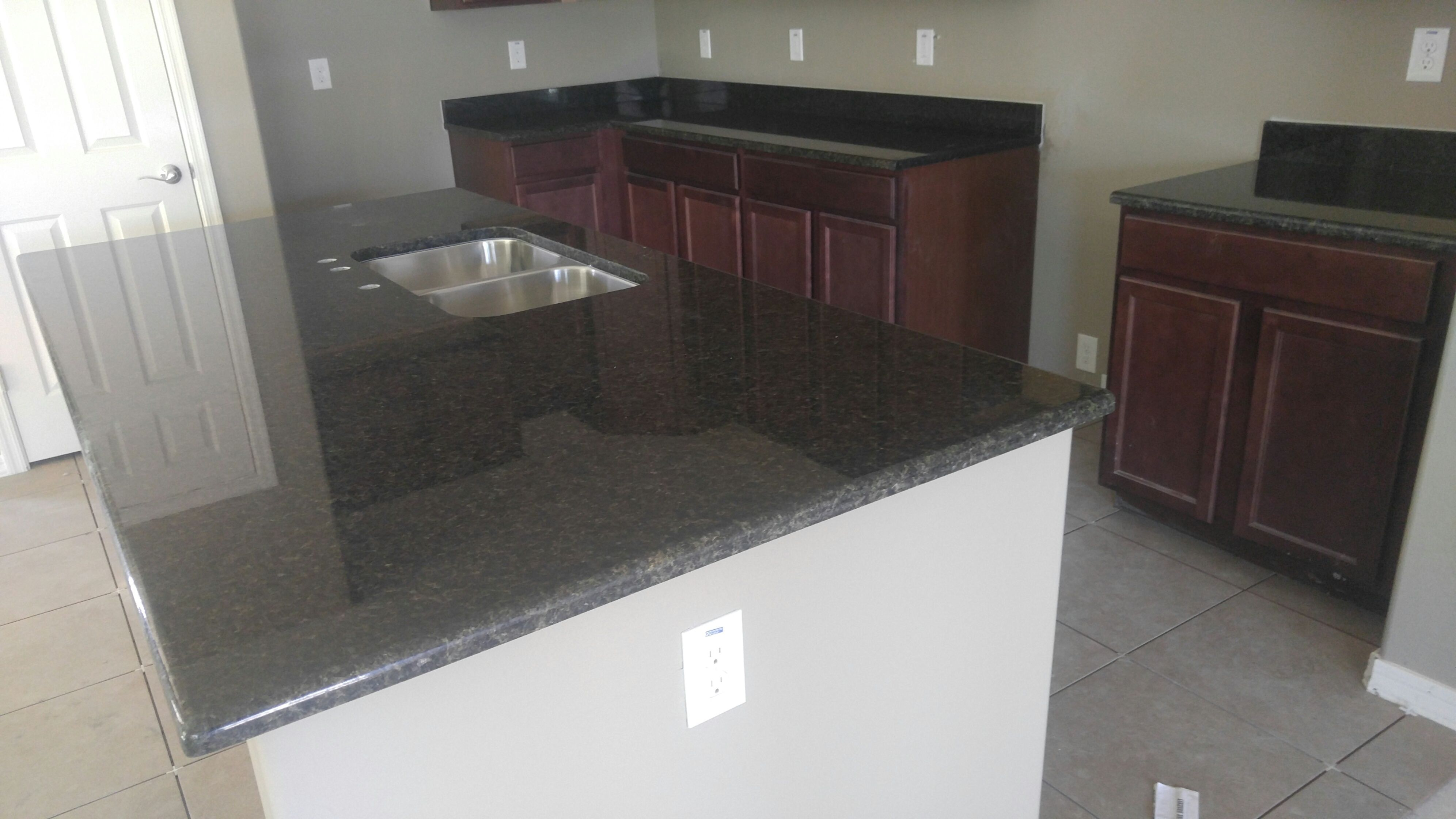 These Countertops Are Verde Uba Tuba Granite. Desert Sky Surfaces Can  Customize Any Type Of Countertop Needed To Complete The Kitchen Or Bathroom  Of Your ...