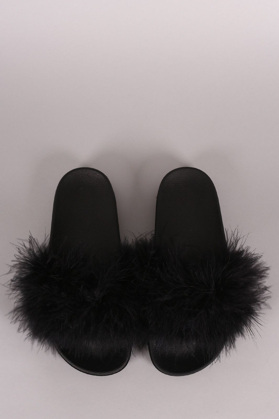 a7370a294aa0fd This fluffy slide sandal features a wide band across vamp with soft faux  feather detail and